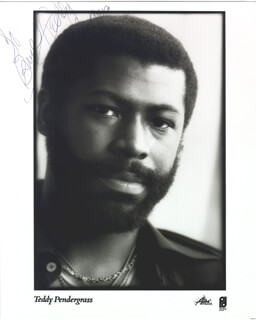 TEDDY PENDERGRASS - INSCRIBED PRINTED PHOTOGRAPH SIGNED IN INK