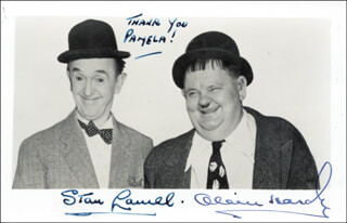 LAUREL & HARDY - INSCRIBED PICTURE POSTCARD SIGNED CO-SIGNED BY: LAUREL & HARDY (OLIVER HARDY), LAUREL & HARDY (STAN LAUREL)