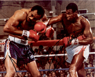 LARRY HOLMES - AUTOGRAPHED SIGNED PHOTOGRAPH