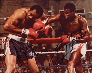 KEN NORTON - AUTOGRAPHED SIGNED PHOTOGRAPH CO-SIGNED BY: LARRY HOLMES