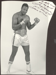 LARRY HOLMES - AUTOGRAPHED INSCRIBED PHOTOGRAPH