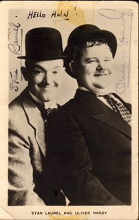 LAUREL & HARDY - AUTOGRAPHED INSCRIBED PHOTOGRAPH CO-SIGNED BY: LAUREL & HARDY (OLIVER HARDY), LAUREL & HARDY (STAN LAUREL)
