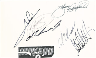 Autographs: MARIO ANDRETTI - SIGNATURE(S) CO-SIGNED BY: AL UNSER JR., AL UNSER, MICHAEL M. ANDRETTI, A. J. FOYT, JOHNNY RUTHERFORD