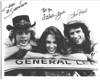 DUKES OF HAZZARD TV CAST - AUTOGRAPHED INSCRIBED PHOTOGRAPH CO-SIGNED BY: JOHN SCHNEIDER, CATHERINE BACH, TOM WOPAT