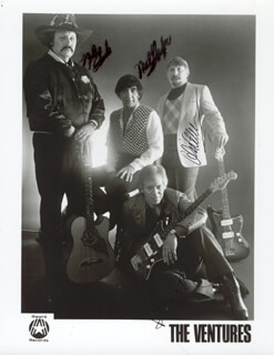 THE VENTURES - AUTOGRAPHED SIGNED PHOTOGRAPH CO-SIGNED BY: THE VENTURES (DON WILSON), THE VENTURES (BOB BOGLE), THE VENTURES (MEL TAYLOR), THE VENTURES (NOKIE EDWARDS)