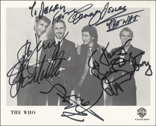 THE WHO - AUTOGRAPHED INSCRIBED PHOTOGRAPH CO-SIGNED BY: THE WHO (ROGER DALTREY), THE WHO (PETER TOWNSHEND), THE WHO (JOHN ENTWISTLE), THE WHO (KENNY JONES)