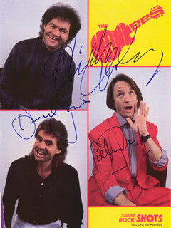 THE MONKEES - MAGAZINE PHOTOGRAPH SIGNED CO-SIGNED BY: THE MONKEES (DAVY JONES), THE MONKEES (MICKEY DOLENZ), THE MONKEES (PETER TORK)
