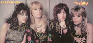 THE BANGLES - MAGAZINE PHOTOGRAPH SIGNED CO-SIGNED BY: THE BANGLES (DEBBI PETERSON), THE BANGLES (VICKI PETERSON), THE BANGLES (SUSANNA HOFFS), THE BANGLES (MICHAEL STEELE)