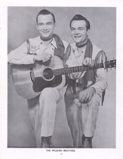 THE WILBURN BROTHERS - MAGAZINE PHOTOGRAPH SIGNED CO-SIGNED BY: WILBURN BROTHERS (DOYLE WILBURN), THE WILBURN BROTHERS (TEDDY WILBURN)