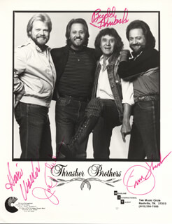 THE THRASHER BROTHERS - AUTOGRAPHED SIGNED PHOTOGRAPH CO-SIGNED BY: THE THRASHER BROTHERS (JIM THRASHER), THE THRASHER BROTHERS (JOE THRASHER), THE THRASHER BROTHERS (BUD THRASHER), THE THRASHER BROTHERS (HOVIE WALKER)