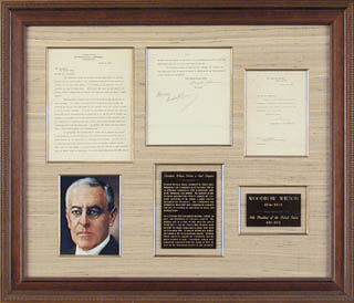 PRESIDENT WOODROW WILSON - AUTOGRAPH ENDORSEMENT SIGNED 03/09/1920 CO-SIGNED BY: JOSEPH P. TUMULTY, HENRY M. ROBINSON