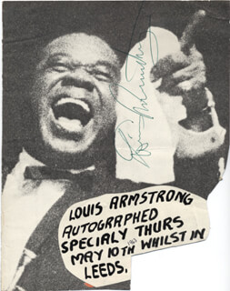 Autographs: LOUIS SATCHMO ARMSTRONG - MAGAZINE PHOTOGRAPH SIGNED CIRCA 1963