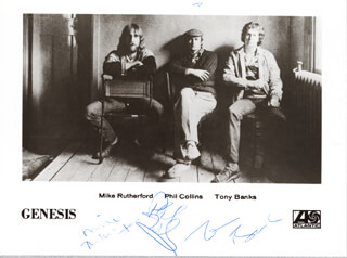 GENESIS - AUTOGRAPHED SIGNED PHOTOGRAPH CO-SIGNED BY: GENESIS (PHIL COLLINS), GENESIS (TONY BANKS), GENESIS (MICHAEL RUTHERFORD)