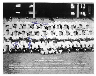 THE NEW YORK YANKEES - AUTOGRAPHED SIGNED PHOTOGRAPH CIRCA 1957 CO-SIGNED BY: YOGI BERRA, FRANK CROSETTI, TONY KUBEK, MICKEY MANTLE, ENOS SLAUGHTER, BOBBY SHANTZ, DON LARSEN, HANK BAUER