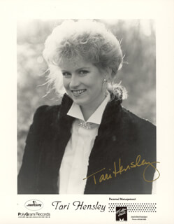 TARI HENSLEY - AUTOGRAPHED SIGNED PHOTOGRAPH
