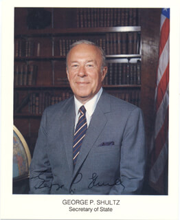 GEORGE P. SHULTZ - PRINTED PHOTOGRAPH SIGNED IN INK