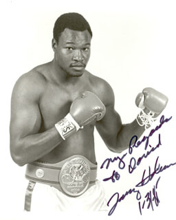 LARRY HOLMES - AUTOGRAPHED INSCRIBED PHOTOGRAPH 01/31/1985