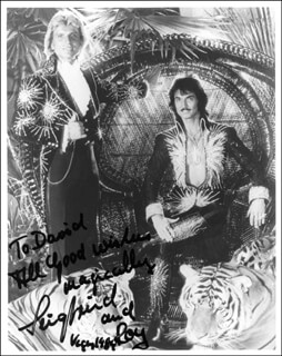 SIEGFRIED & ROY - AUTOGRAPHED INSCRIBED PHOTOGRAPH 1984 CO-SIGNED BY: SIEGFRIED & ROY (ROY HORN), SIEGFRIED & ROY (SIEGFRIED FISCHBACHER)